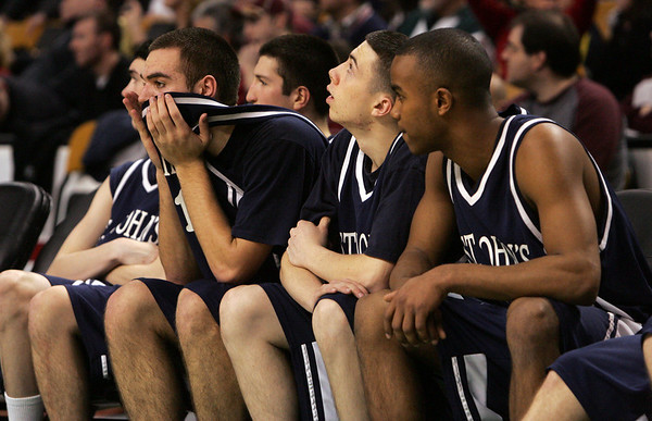 St. John's bench is visibly disappointed as they trailed Central Catholic with just seconds left in the game during last night's Division 1 Sectional Finals at the Garden Friday evening. Photo by Deborah Parker/March 5, 2010