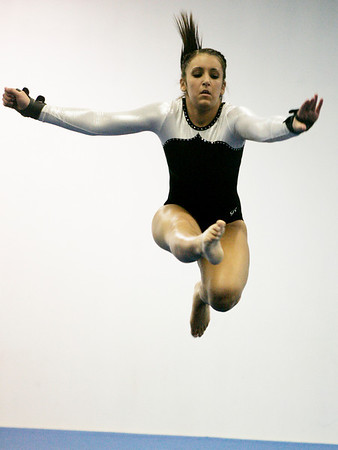 Salem: Bishop Fenwick's Fallon Anemoduris performs her floor routine during the Crusader Inviational held at Baker's gym Friday night. Photo by Deborah Parker/Salem News Friday, January 30, 2009.
