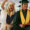 Senior Class President Kiah Domoracki of Beverly and Vice President Edwin Santana of Methuen celebrate the end of the graduation ceremony of Essex Agricultural and Technical High School Thursday evening. The class of 2009 graduated 85 students. Photo by Deborah Parker/June 4, 2009