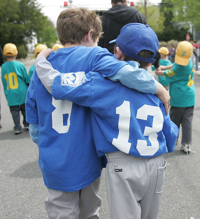 Colt team members, Matthew Szpak, 7, and David Hunt, 6, both of Salem, walk together during the Annual Salem Little League Parade Sunday morning. Starting at Salem State College, the parade crossed Lafayette Street and ended at Forest River Park. Photo by Deborah Parker/April 25, 2010