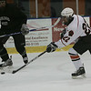 Beverly's Connor Irving scores against Marblehead's Tony Cuzner during a schrimmage held at Salem State Monday evening. photo by deborah parker/december 6, 2010
