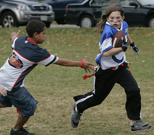 Peabody: Hope Pare out runs a defender during their flag football game at Emerson Park Saturday. Photo by Deborah Parker/Salem News Saturday, October 25, 2008