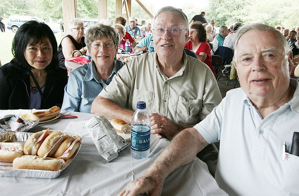 Roberta Hung, Beverly and Jim Barnes, along with David Goggin, all of Salem, pose together while attending the Seniors Picnic held at Winter Island Sunday afternoon. Photo by Deborah Parker/August 9, 2009