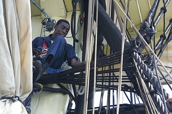 Seaman Lance Devero has a birds eye view while perched up in the rafters while aboard the Friendship out at sea Tuesday. These are sailors who will work aboard the USS Constitution. They have been doing dry dock training since May and have been out to sea with the Friendship over the past three days. Photo by Deborah Parker/July 14, 2010