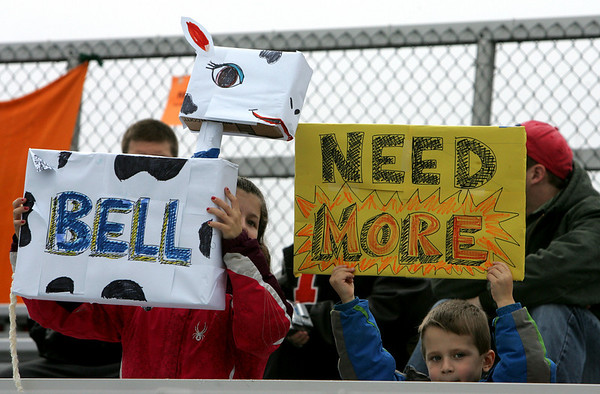 Morgan Monroe, 8, and her brother, Joshua, 5, of Ipswich, show their support for the Ipswich High School band before the start of the Thanksgiving football game against Hamilton-Wenham. Photo by Deborah Parker/November 26, 2009