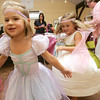 Geogia Rossetti, 4, and Olivia Romans, 4, both of Hamilton, twirl in their dresses while attending the Fancy Nancy Soiree at the Wenham Museum, Tuesday afternoon. Attendees were read a Fancy Nancy story, created a fancy craft and were treated to ice cream. Photo by Deborah Parker/August 24, 2010