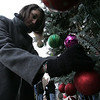 Kayla Arsenault, 13, of Lynn, hangs an ornament on a tree as part of a Holiday Candlelight Service at Puritan Lawn Memorial Park in Peabody Sunday afternoon. photo by deborah parker/decemebr 5, 2010