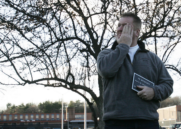 Mike McCarthy, father of Kevin McCarthy, a former Danvers High soccer player, who died in a car crash last month, reacts after he received a plaque dedicating a bench in his son's honor at the soccer fields. The bench and plaque were donated by some of Mike's coworkers from IBM, who surprised him with the dedication. photo by deborah parker/november 19, 2010
