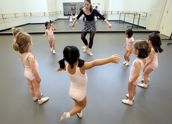 Marblehead: Lily Winch stretches her arms to her classmates while forming a circle during dance class at the Boston Ballet School located in the new Marblehead YMCA.  Photo by Deborah Parker/Salem News Thursday, February, 12, 2009.
