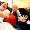 Mark Goldberg of Beverly Farms laughs with his son, Matthew, 38 while at Bridgewell, a new group home in Beverly. There are 5 men that range in age from 38 to 72, who have previously spend most of their adult lives in an institutional nursing home. Three are nonverbal inlcuding Matthew, who suffered brain damage from a motocycle accident when he was 21, and another man has cerebral palsy. Since coming to Bridgwell, they've had a much better quality of life. Photo by Deborah Parker/July 7, 2009