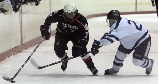 Beverly's Andrew Irving and Peabody Matt Rodgers fight for control of the puck  during Wednesday night game at Mcvann-O'Keefe Rink in Peabody. Photo byDeborah Parker/December 23, 2009
