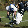 Hamilton: Pingree's Derek Pratt escapes the grasp of Holderness' Zander Borisczky during Saturday's game at Pingree.<br /> Photo by Deborah Parker/Salem News Saturday, October 11, 2008