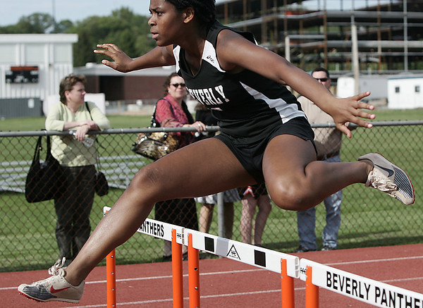 Beverly: Beverly's Janelle Louis competes in the 100 meter hurdle during yesterday's meet held at Beverly High School. Photo by Deborah Parker/May 20, 2009.