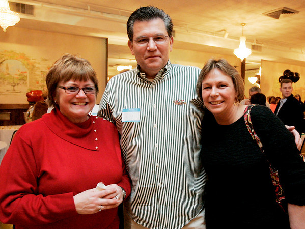 Beverly: From left, Jane Bates, Bill Pluckhahn, and Page Forster, all of Beverly pose together while attending Casino Night to to benefit Cove Elementary PTO<br /> held at the Vittori Rocci Post Friday evening. Photo by Deborah Parker/Salem News Friday March 6, 2009.