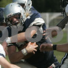 Hamilton: Hamilton Wenham's Luke Drieze is blcoked by Lynnfield's defensive line during yesterday's game held at Hamilton-Wenham. Photo by Deborah Parker/Salem News Saturday, September 13, 2008