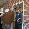 Sterling employees Bryan Hume and Tyler Rodway move a table out of an office the old Beverly High School which will be moved to the new high school building. photo by deborah parker/november 24, 2010