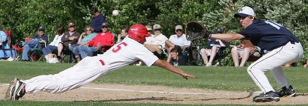 Masco's Jason Katz tries to make it back to first base before the ball against Wilmington's Cole Peffer during  Monday's Division 2 North quarterfinal's state tournament game held in Topsfield. Photo by Deborah Parker/June 7, 2010