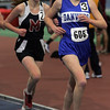 Marblehead's Mary Kauffman and Danvers' Haley Dyer compete in the 2 mile during yesterday's NEC Championship meet held at the Reggie Lewis Center in Boston. Photo by Deborah Parker/February 4, 2009