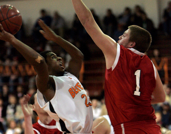 Beverly: Beverly's Mike Clayton is defended by Salem's Danny Byors in front of the net during last night's game at Beverly High School. Photo by Deborah Parker/Salem News Friday, February 13, 2009.