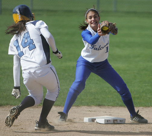 Danvers' Gabby Vega looks to tag Peabody's Kaleigh Ryan at second base during yesterday's game held at Danvers. Photo by Deborah Parker/May 11, 2010