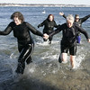 Salem: From left, Jaimie Hoover of Malden, Elizabeth Black of Beverly, Maureen Olson of Malden and Becky Christie of Salem quickly make their way out of the water during yesterday's Polar Swim at Juniper Point Beach. This is the ninth year that a group of people have gathered to jump into the frigid water. Photo by Deborah Parker/Salem News Thursday, January 01, 2009