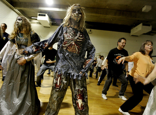 "Salem: Caitlin Moreau, 12, of Conneticut helped an attempt to break a Guinness record for having the most people dance the ""Thriller"" zombie dance at one time. On Saturday people gathered at Salem State College and joined together with people all over the world to dance at the same time.<br /> Photo by Deborah Parker/Salem News Saturday, October 25, 2008"