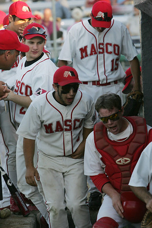 Masco's Jason Schwartz and Colin Shepard try to cheer on their team during the Eastern Massachusetts Championship State semifinals Division 2 game against Duxbury held at Alumni Field in Lowell Tuesday evening. Photo by Deborah Parker/June 15, 2010
