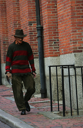 Jeremy Lander of Salem dressed as Freddy Kruger walks past the Old Town Hall early Halloween evening. Photo by Deborah Parker/October 31, 2009