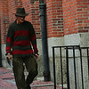 Jeremy Lander of Salem dressed as Freddy Kruger walks past the Old Town Hall early Halloween evening. Photo by Deborah Parker/October 31, 2009