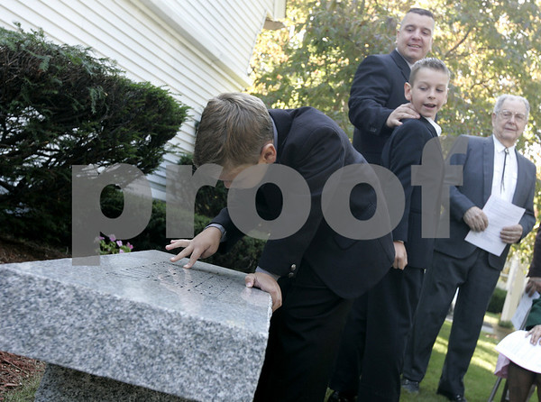 Danvers: Nicholas Symmes, 6, grandson of David T. Symmes, examines the bench dedicated to his grandfather outside of Calvary Episcopal Church Sunday. Symmes, who passed away earlier this year, was the church's finance chairman and devoted parishioner and volunteer. The unveiling coincided with a celebration of the church's 150th anniversary.Photo by Deborah Parker/Salem News Sunday, September 21, 2008