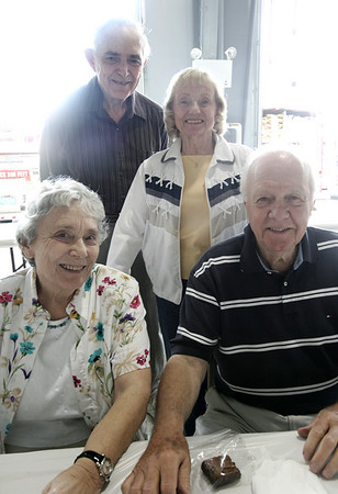 Dorothy and Robert Woodbury, front, and Dorris and John Suminsby, all of Wenham pose together while atteding the first ever chicken barbeque, a fundraiser for the Hamilton Fire Department. Photo by Deborah Parker/Juen 20, 2009