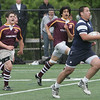St. John's Nate Cyr runs the ball down the field during yesterday's match against Boston College High held at St. John's Prep. Photo by Deborah Parker/May 18, 2010
