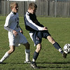 Danvers: St. John's Kelley Johnson defends against Central Catholic's Adam Jonhson during Saturday's game at St. John's Prep. Photo by Deborah Parker/Salem News Saturday, October 18, 2008