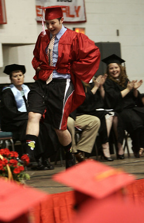 Jeremiah Jennings dances across the stage to receive his diploma during Friday night's ceremony at Salem High School. Photo by Deborah Parker/ June 5, 2009