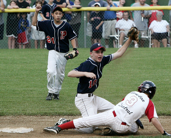 Peabody West's Matt Hosman holds up his glove to signal the out after tagging Newton Central's Zeke Berg at second during yesterday's State Little League Final Four held at Harry Ball Field. Photo by Deborah Parker/ July 30, 2009