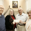 On Friday, Pat Cirone, center, Director of the Beverly Public Library, accepted a check from John Carr, on behalf of the graduating class of 1945. Instead of having a renuion the class decided to present a check to the library to go towards a new book mobile. From left, John Burnes, reunion class treasurer, Pat Cirone, director of the library, John Carr, class president, and Alice Burns reunion recording secretary. Photo by Deborah Parker/June 12, 2009.
