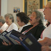 Members of the Goldentones, a singing group from the Salem Council on Aging, perform for a crowd at Grovernor's Park in Salem Thursday afternoon. Photo by Deborah Parker/September 2, 2010