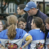 Peabody: Coach Austin Bradshaw talks with his all girl flag football team during at time out at their game against an all boys team Saturday morning. Photo by Deborah Parker/Salem News Saturday, October 25, 2008
