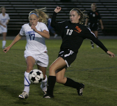 Danvers: Danvers' Corey Persson and Beverly's Meghan Chatellier fight for control of the ball during Thursday night's game at Deering Stadium. Photo by Deborah Parker/Salem News Thursday, September 25, 2008