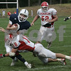 Danvers: St. John Prep's Greg Donahue is tackled by Masconomet's (*18 is not on the roster) during Saturday's game held at St. John's. As of the third period St. John's was leading 22-7.<br /> Photo by Deborah Parker/Salem News Saturday, September 06, 2008