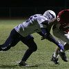 Masconomet's Kurt Hunziker is takcled by Triton's Derek Paquette during Friday night's game at Masconomet. Photo by Deborah Parker/October 23, 2009