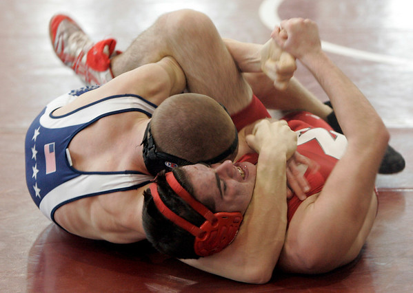 Topsfield: Masconomet's MIke Nay wrestles with Hamilton-Wenham's Kendrick Poulin in the 135lb heat during Saturday's meet held at Masconomet. Photo by Deborah Parker/Salem News Saturday, January 24, 2009.