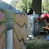Tommy Gagnon works on painting several cement blocks at the entrance to the Salem Willows with images that represent the city, such as a lobster, a lighthouse, a ship, a headstone and more. Photo by Deborah Parker/Septmeber 1,2 010