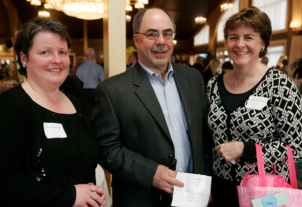 "Danvers: Denise Deschamps, Brian Nardella and his wife Maureen, all of Beverly pose together while attending the St. John's Annual Auction pose held at the Danversport Yacht Club. This year's auction, ""See Us Shine 2009"" helps to raise money for the school. Photo by Deborah Parker/Salem News Friday, March 27, 2009."