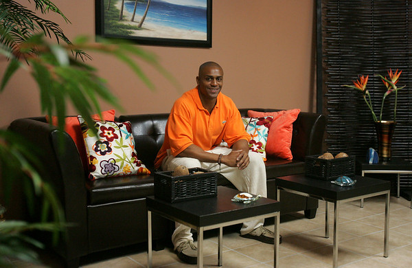 Former Patriots player David Givens, sits in the wi-fi lounge of his new cafe, Euphoria Lifestyle Cafe, that he recently opened in the Cummings Center off Rte 62 in Beverly. Photo by Deborah Parker/June 16, 2010