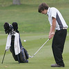 St. John's Nick Velonis puts on the first hole during yesterday's match against Masconomet held at Kernwood Country Club. Photo by Deborah Parker/October 21, 2009
