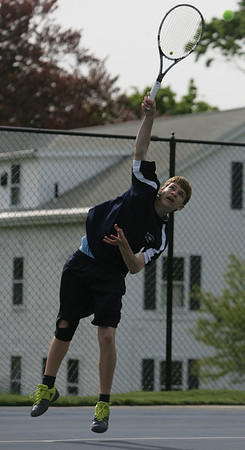 St. John's Chris Toner competes in yesterday's match against Marblehead held in Danvers. Photo by Deborah Parker/May 11, 2010