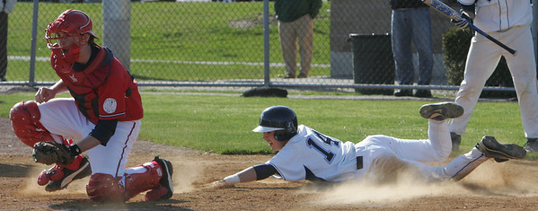Danvers' Nick Gikas tags home plate before Saugus' Paul Andrews receives the ball during Thursday's game held at Danvers High School. Photo by Deborah Parker/April 15, 2010