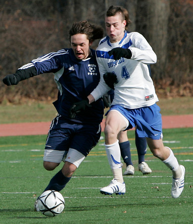 Lowell: Hamilton-Wenham's _____???? fights for control of the ball with Bromfield's Ian McCracken during Saturday's Division 3 State Championship held in Lowell. Hamilton-Wenham lost 4-2. Photo by Deborah Parker/Salem News Saturday November 22, 2008.