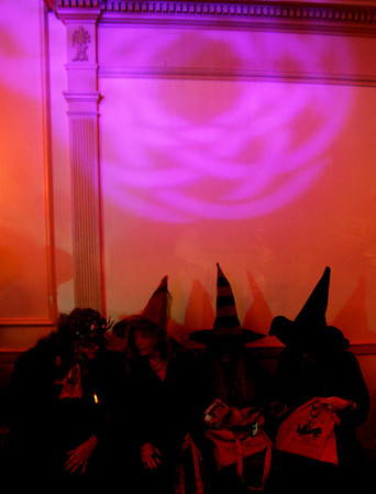 Several witches sit chat together during the Witches' Ball held at the Hawthorne Hotel Friday evening. Photo by Deborah Parker/October 30, 2009